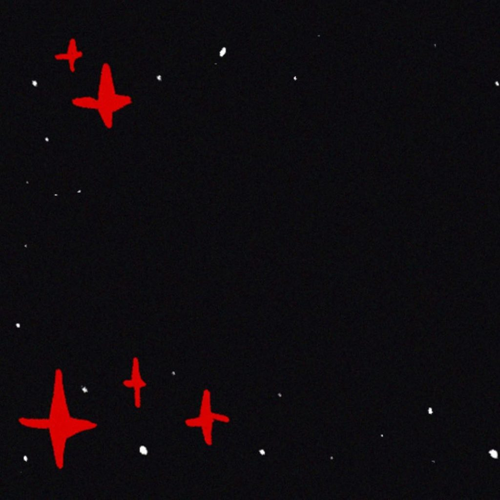 Black square with red stars and white dots